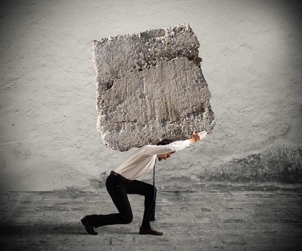 ERISA-Attorney_Man Carrying Large Rock on Back_Depositphotos_126376800_m-2015.jpg